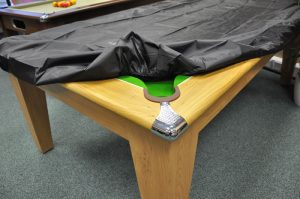 A cloth cover is a must to remove dust from the pool table